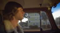 Surfer Driving Around Town video