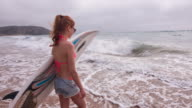 Young Woman Going Surfing video