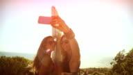 Surfer girls taking a selfie video