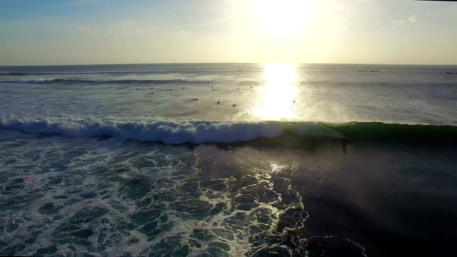 Surfer jumping up from a wave video