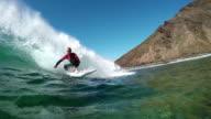 SLOW MOTION UNDERWATER: Surfer man surfing big wave pass camera video