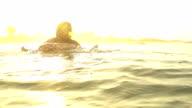 SLOW MOTION: Surfer paddling at sunset in Sri Lanka video