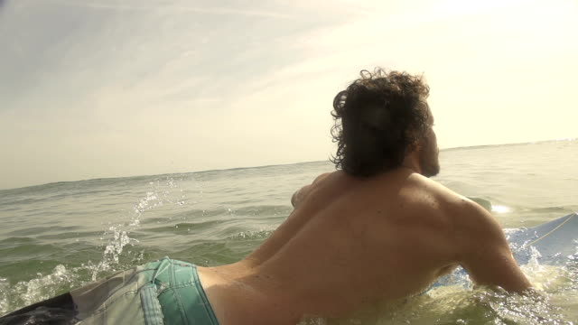SLOW MOTION: Surfer paddling out video