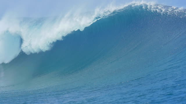 SLOW MOTION: Surfer paddling over big tube wave to lineup video
