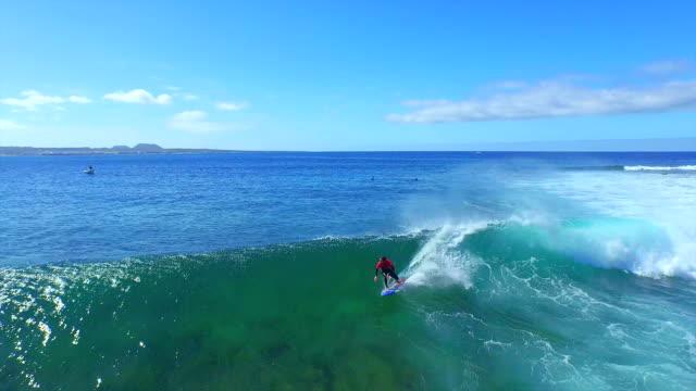 AERIAL: Surfer riding big fast wave in Canary Islands video