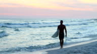 Surfer Walking At Sunset video