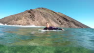 SLOW MOTION: Surfer woman paddling towards the line-up video