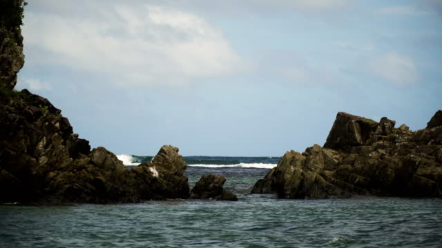Surfers on the waves.Catanduanes, Philippines video