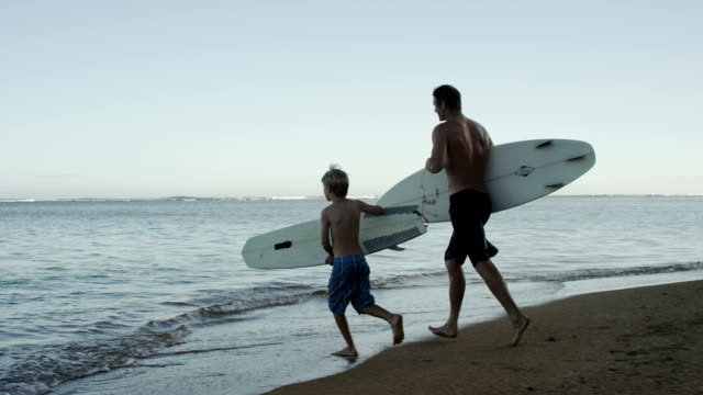 Surfing family at the beach video