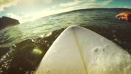 Surfing pov with action camera: paddling video