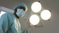 Surgeon directs surgical light in camera video