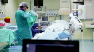 Surgeon prepares a patient for operation video