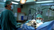 Surgeons operating a patient video