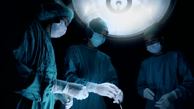 Surgery team operating in a surgical room video