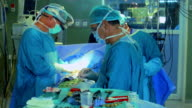 Surgical team operating a patient video