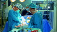 Surgical team operating on heart video