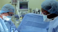 Surgical Team Working In Operating Theatre video