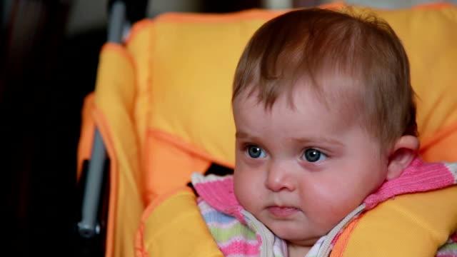 Surprised baby sitting in the pram video