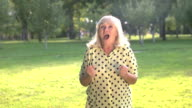 Surprised lady is smiling. video
