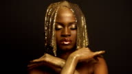 Surreal Fashion Portrait of African American Female Model with Golden Glossy Headwear. Creative Vogue Concept, Black Studio Background video