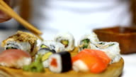 Sushi and wasabi eating. Close up video