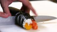 Sushi Chef Cutting Salmon Peach Futomaki Roll video