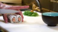 Sushi Chef Cutting Salmon Uramaki Roll video