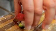 Sushi chef cutting sushi rolls video