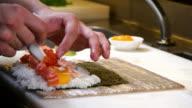Sushi Chef Preparing Salmon Peach Futomaki Roll video