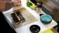 Sushi Chef Preparing Salmon Uramaki Roll video