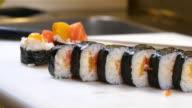 Sushi Chef Presenting Salmon Peach Futomaki Roll video