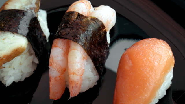 Sushi on black plate video