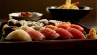 Sushi plate. Macro pan shot of a variety of sushi on a plate. video