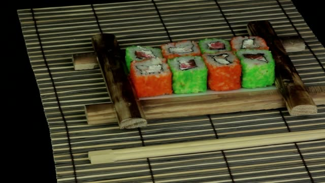 Sushi roll on wooden frame loop video
