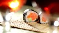 Sushi rolls and plum wine. Beautiful shallow dof. video