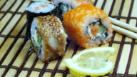 Sushi Rolls on a Bamboo Mat Rotates video