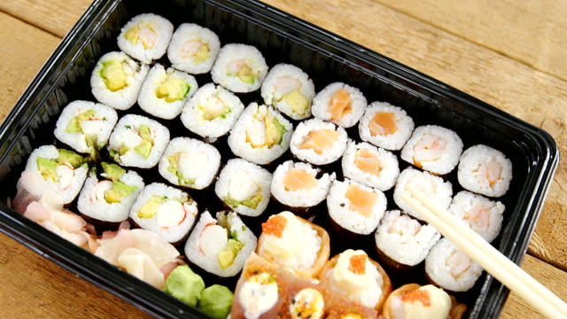 Sushi rolls with salmon in plastic tray video