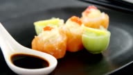 Sushi served on plate with chopsticks and sauce video