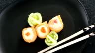 Sushi served on plate with chopsticks video