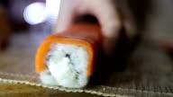 Sushi set prepared on wooden sushi rag video
