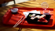 Sushi sets on a tray at an outdoor restaurant video