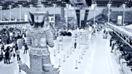 Suvarnabhumi. Travellers queing to check-in at an International Airport video