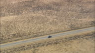 SUVs On Route 789 Towards Jeffrey City  - Aerial View - Wyoming, Fremont County, United States video