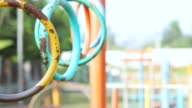 swaying gymnastic rings for kids in playground video