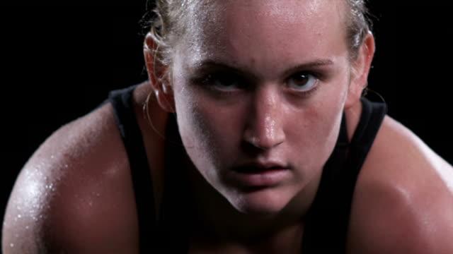 Sweaty Female Athlete Stares at Camera video
