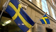 Swedish flags on the facade of the building in the Old Town in Stockholm. video
