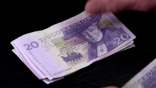 Swedish Krona counted on a table video