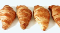 Sweet croissants on white background video