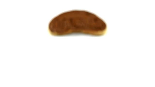 Sweet dreams concept. Chocolate spreaded on a bread video