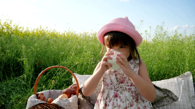 sweet girl beverage from dairy products, Pleasure on child's face, milk advertising, Healthy food for children, little female child video